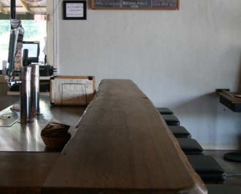 The Local Public House: River-Recovered Heart Cypress Bar Tops make an Impression 1