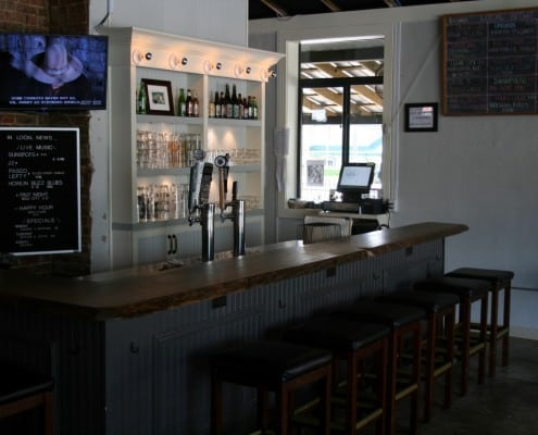 The Local Public House: River-Recovered Heart Cypress Bar Tops make an Impression 3