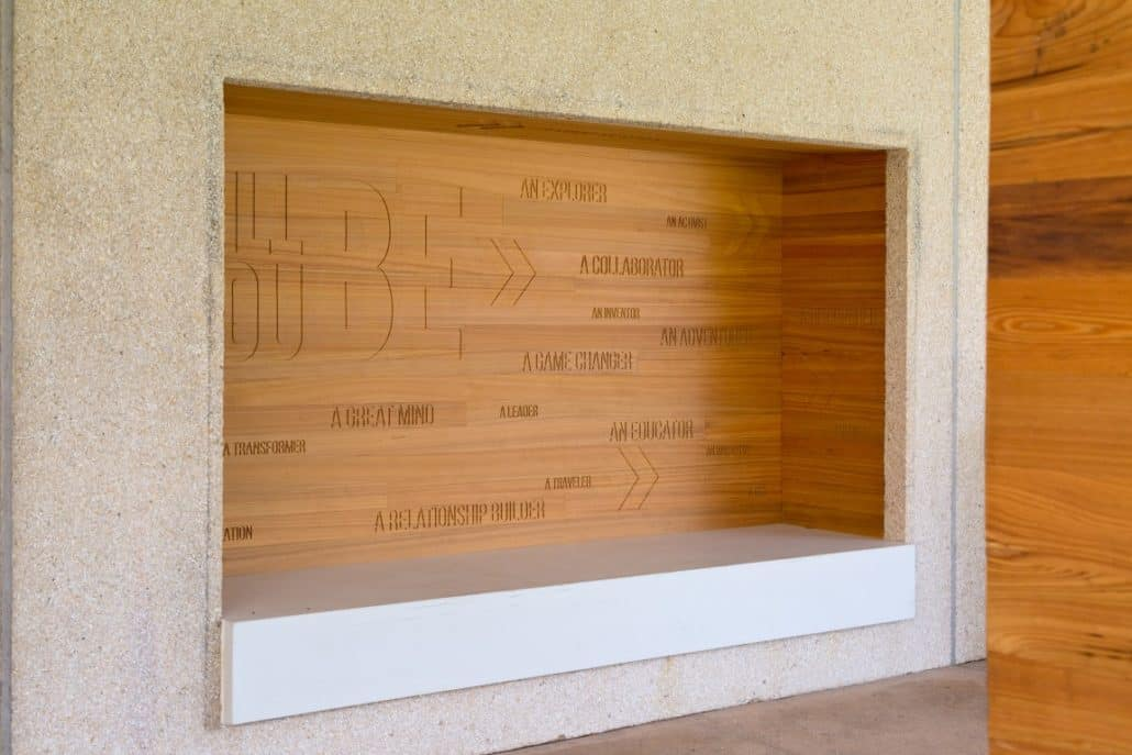 BFrank Studio's attention to detail even included an exterior accent wall routed with inspirational text and applied into an alcove bench.